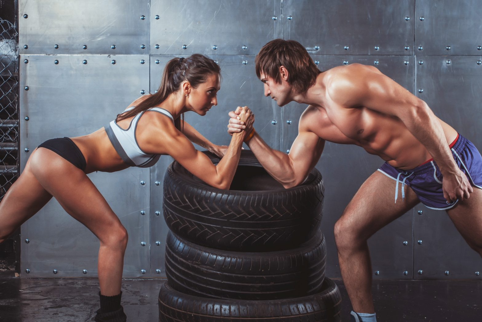 Athlete,muscular,sportsmen,man,and,woman,with,hands,clasped,arm